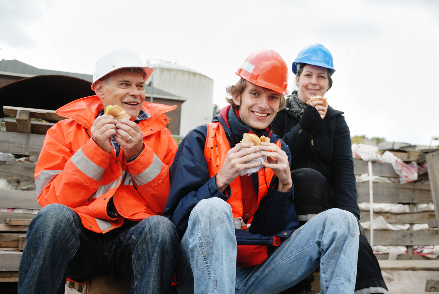 Construction workers having lunch on site